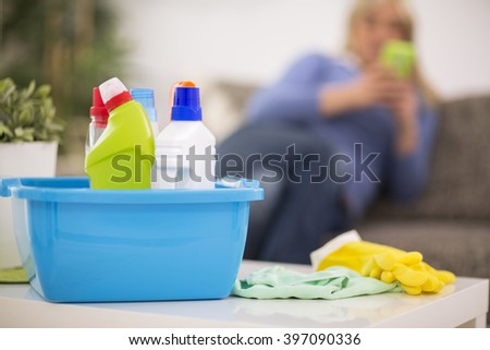 Short break from cleaning home - stock photo