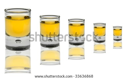 5 shot glasses of different sizes with alcohol isolated on white background - stock photo