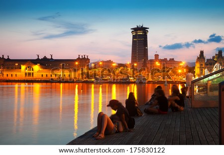 shot of Columbus Monument and quay in evening. Barcelona - stock photo