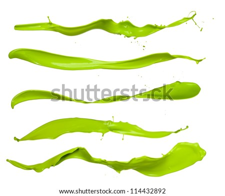 Shot of green paint splashes, isolated on white background - stock photo