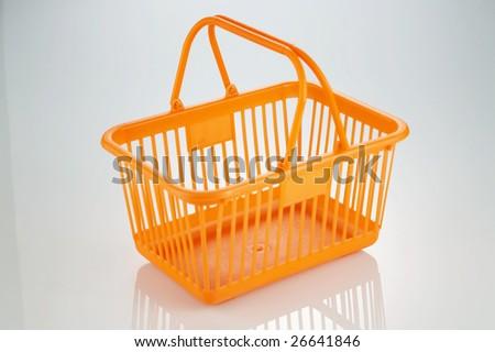 shot of shopping basket on the plain background - stock photo