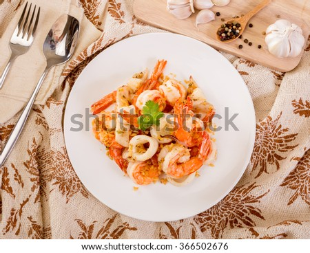shrimp and squid fried with garlic pepper - stock photo