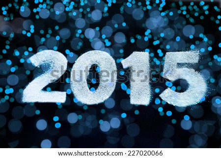 2015 sign for happy new year card with defocused bokeh. - stock photo