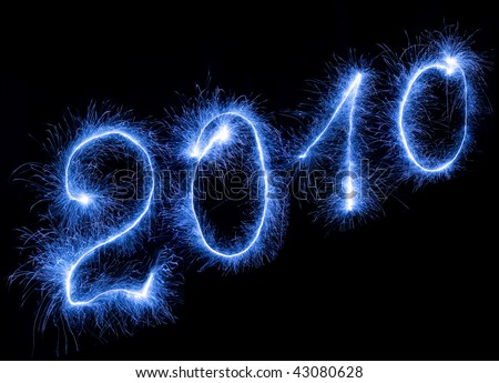 2010 sign made by light on a black background - stock photo