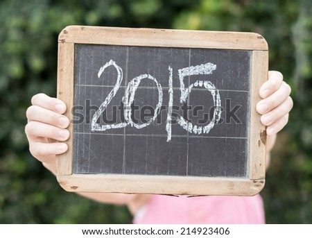 2015 sign on a vintage chalkboard - stock photo