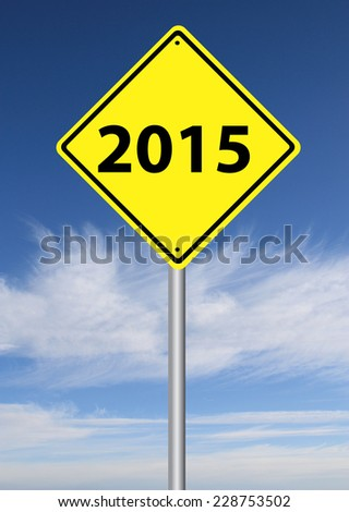 2015 sign with blue cloudy sky in the background - stock photo