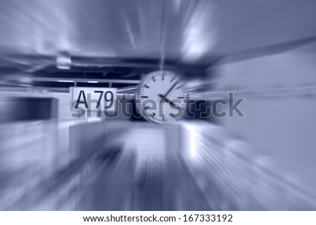 signboard in futuristic gate of the airport transfer. Radial blur. - stock photo