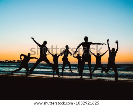 stock-photo--silhouette-of-a-group-of-fr