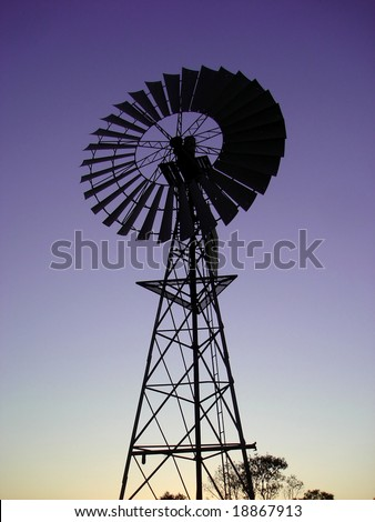 Silhouette of a windmill - stock photo
