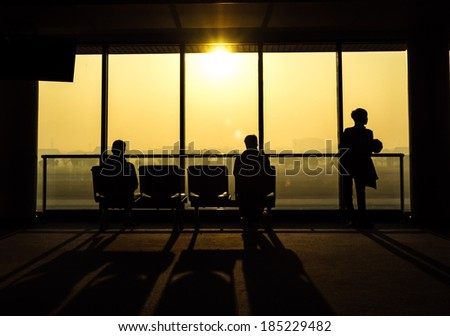 Silhouette of people waiting for departure from airport - stock photo