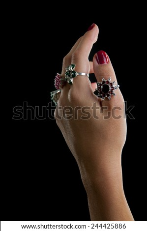 Silver collection of rings with gem stones (marcasite, green onyx, garnets, emerald, ruby) isolated on black background - stock photo