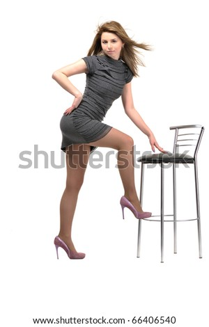 sitting on stool  young and beautiful girl. isolated on white background - stock photo