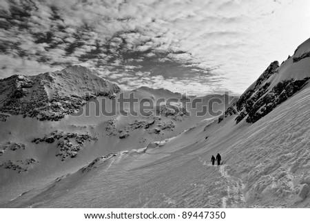 2 Skiers - stock photo