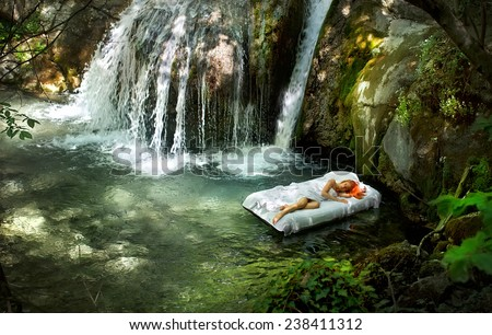 Sleeping woman in deep forest with waterfall on back - stock photo