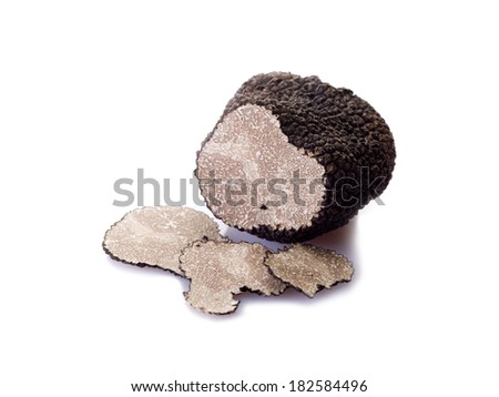 slice black truffle on white background - stock photo