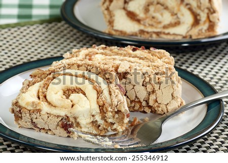 slice of toffee and pecan roulade with fresh cream                              - stock photo