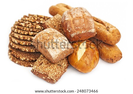 Slices of wholewheat bread and diversity of biscuits isolated on white background - stock photo