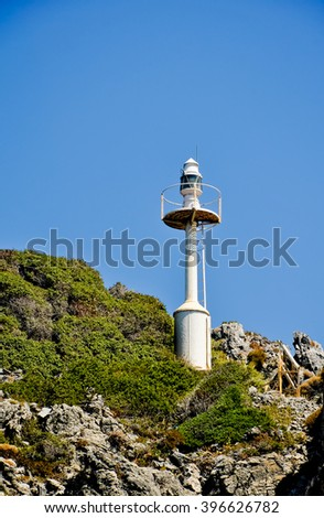 Small lighthouse on Samos island coast, Greece - stock photo