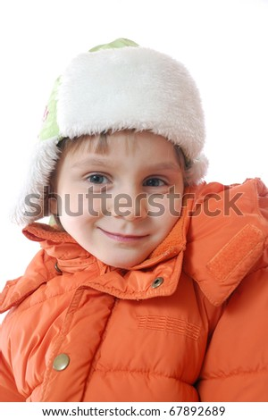smiling girl in an orange coat and a flapped fur hat
