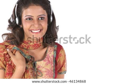 Smiling girl listening music - stock photo