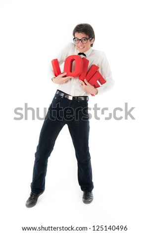 smiling young man holds a large red letters love - stock photo