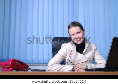 .smilling young businesswoman at office