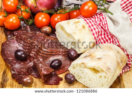 Smoked prosciutto with bread and tomatoes, Selective focus - stock photo