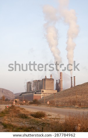 Smoking pipes to against blue sky and air pollution. - stock photo