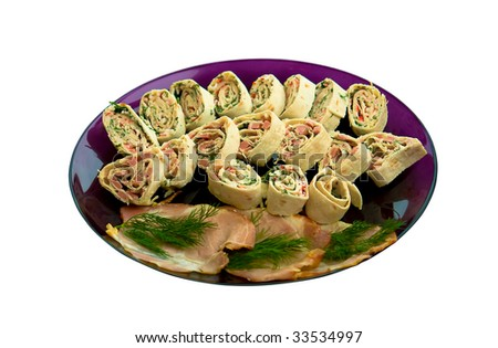 snacks from the rolls with crab meat, herbs and bacon