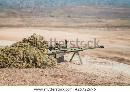 Sniper in camouflage suits on the ground