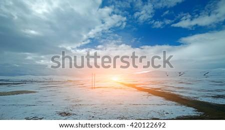 Snow mountain landscape of the grasslands - stock photo