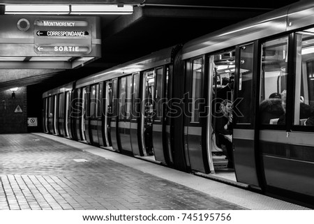 """Snowdon Boarding"" - March 13th, 2017: A view of a train shortly after passengers have boarded at Snowdon Metro Station in Montreal, Canada."
