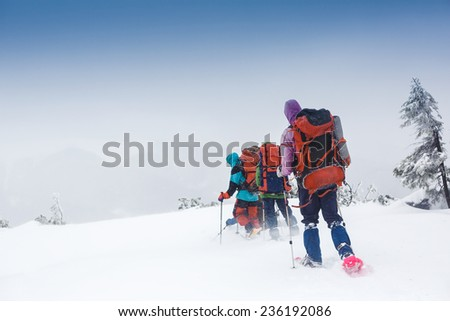 snowshoeing in winter Carpathian mountains - stock photo