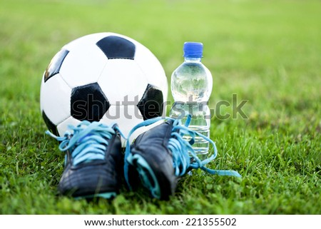 Soccer ball and shoes - stock photo