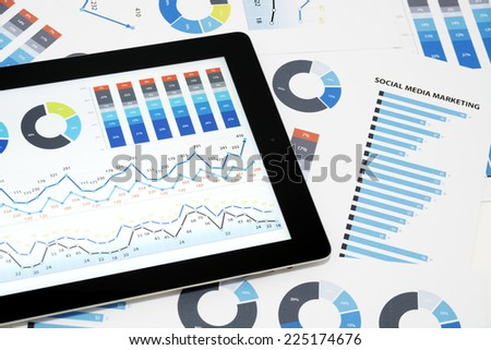 Social Media Marketing. Business charts and diagrams on digital tablet. - stock photo