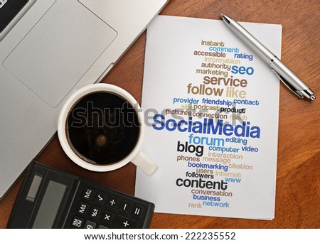 """SOCIAL MEDIA word cloud arrangement"" Notebook with text vision on table with coffee, calculator and notebook - stock photo"