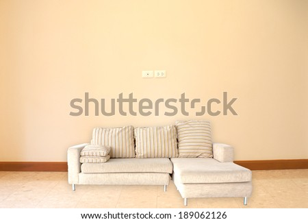 sofa on floor and wallpaper  background in room. - stock photo