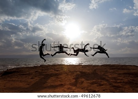 "...some guys with Dead-Sea-mud on their skin, are performing a funny jumping scene in front of the dead sea in jordan. ""Over the sea, some Miles beyond the mountains is Jerusalem""."