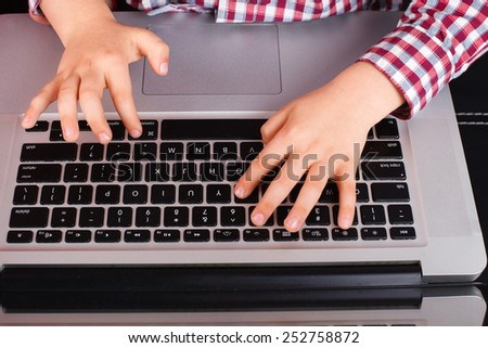 Son Using Laptop At Home, hands close - stock photo