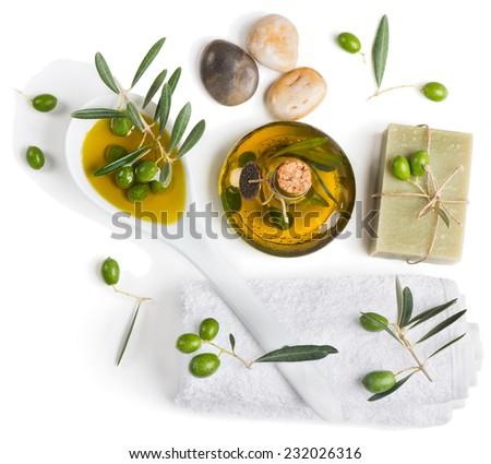 Spa and wellness setting with zen stone, olives and towel on white background, top view. - stock photo