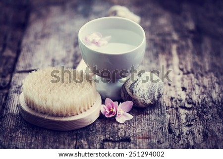 Spa concept background with flower, water and stone - stock photo