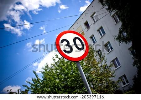 30 speed limit sign. - stock photo