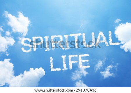 """SPIRITUAL LIFE"" cloud word on sky. - stock photo"