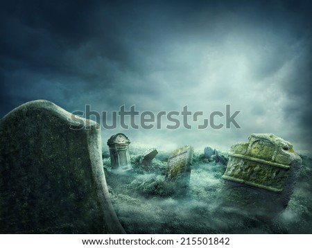 Spooky old graveyard at night - stock photo