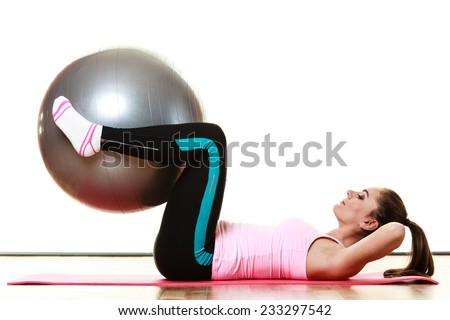 sport, training, gym and lifestyle concept. Young happy woman doing fitness exercises with fit ball isolated on white - stock photo