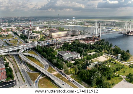 ST-PETERSBURG, RUSSIA - JULY 19, 2007:  Road interchange Ring Road and Avenue Obukhovskoy Oborony before  bridge Bolshoi Obuhovsky. Bridge is under construction second part. Bridge over the River