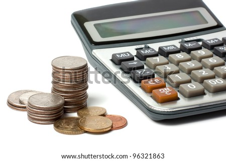 stack of coins and calculator isolated on white - stock photo