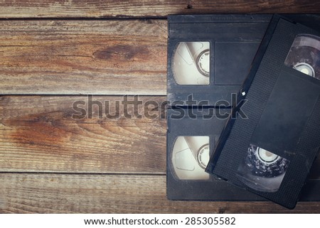 stack of VHS video tape cassette over wooden background. top view photo - stock photo