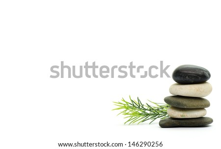 Stacked stone on white background with rosemary - stock photo