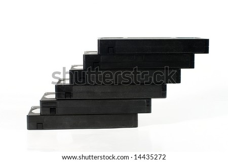 """Staircase"" of old video tapes (on a white background) - stock photo"